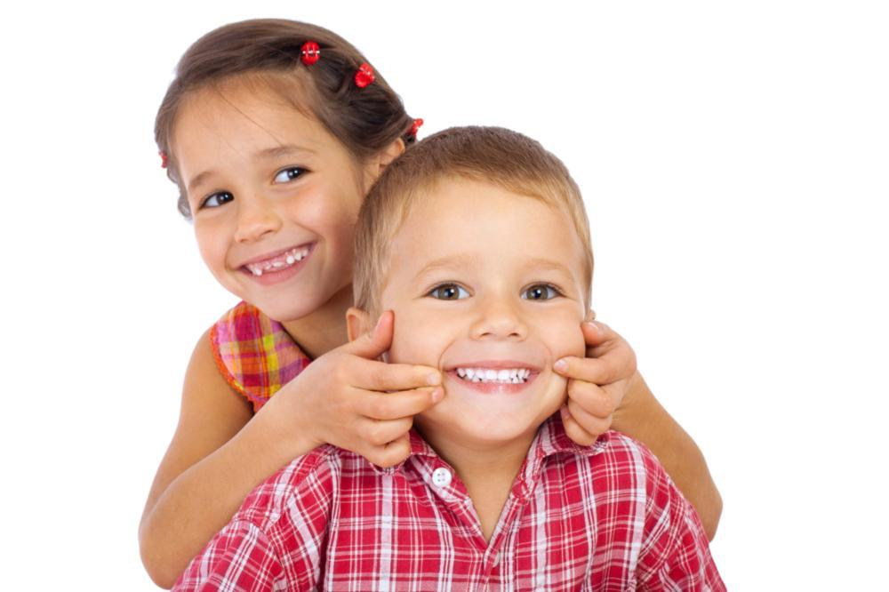 Young boy and girl smiling | Dentist Greeley CO
