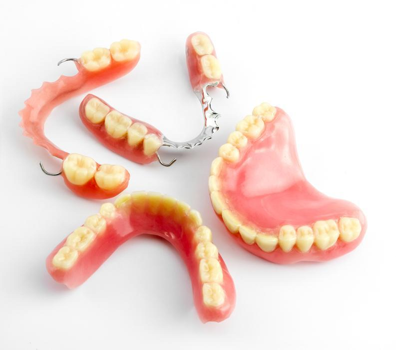 Sets of full & partial dentures at dentist office in Greeley CO