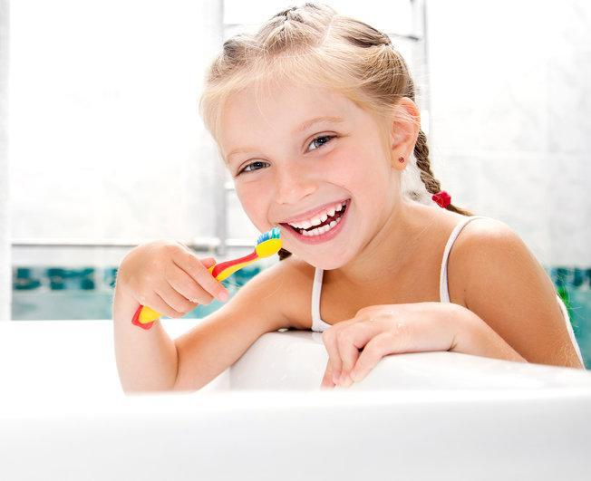 Young girl brushing teeth | Dentist Greeley CO