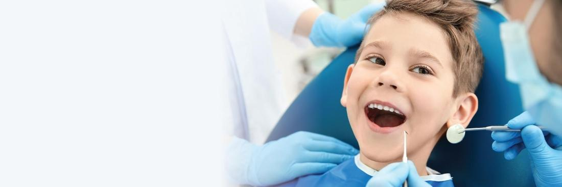 Little kid smiling in dental chair | Dentist Greeley CO