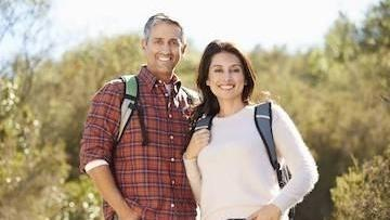 Couple hiking | Complete dentures greeley co