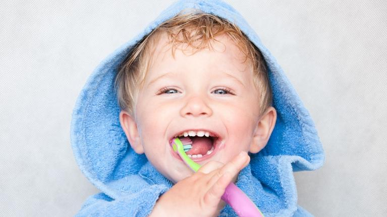 Young child brushing teeth | Dentist Greeley CO