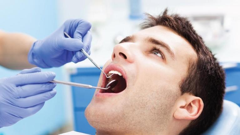Man getting emergency dental care in Greeley, CO | Norco Family Dental
