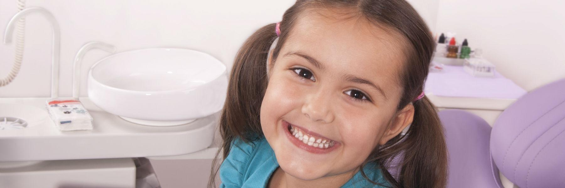 Little girl sitting in dental chair smiling | Dentist Greeley CO