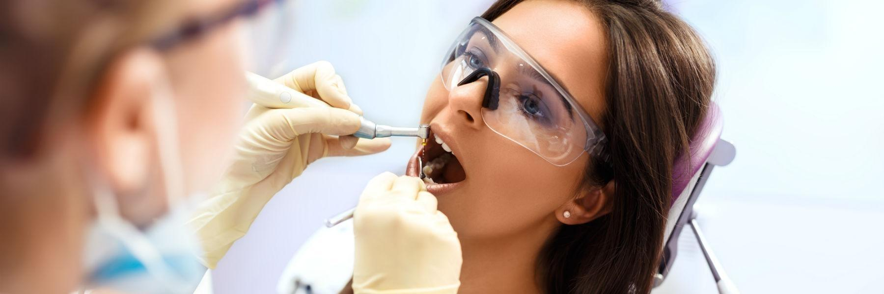 Woman getting dental work done | Dentist Greeley CO