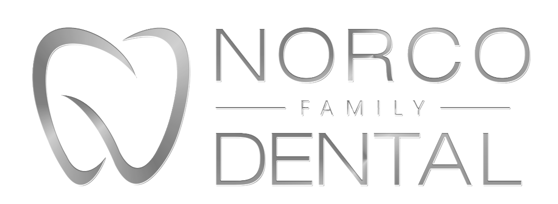 Grey Tooth Design with Norco Family Dental on the right